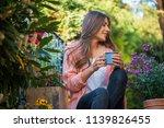 beautiful young girl smiling... | Shutterstock . vector #1139826455
