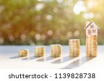 coins on the wood and house in... | Shutterstock . vector #1139828738