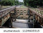 train overpass with pedestrian... | Shutterstock . vector #1139835515