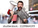 surprised handsome man with... | Shutterstock . vector #1139864195