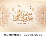 arabic calligraphy text of eid... | Shutterstock .eps vector #1139870138