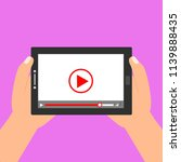 hands holding tablet with video ...