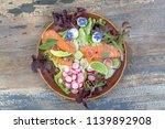 caesar salad with salmon. mix... | Shutterstock . vector #1139892908