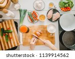 female chopping the meat ... | Shutterstock . vector #1139914562