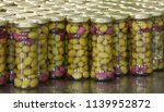 olives in packaging line. | Shutterstock . vector #1139952872