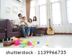 happy asian family in living... | Shutterstock . vector #1139966735