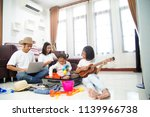 happy asian family using laptop ... | Shutterstock . vector #1139966738