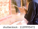 asian woman praying with... | Shutterstock . vector #1139995472