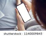 close up woman hand using a... | Shutterstock . vector #1140009845