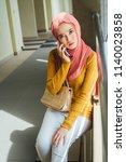 beautiful malaysian girl using...   Shutterstock . vector #1140023858