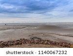 wind farms on coastal beaches... | Shutterstock . vector #1140067232