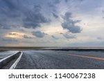 wind farms on the coastal... | Shutterstock . vector #1140067238
