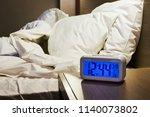 electronic alarm clock stands... | Shutterstock . vector #1140073802