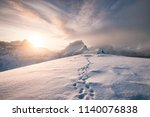 snowy mountain ridge with... | Shutterstock . vector #1140076838