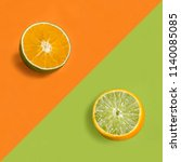 orange in lime peel on orange... | Shutterstock . vector #1140085085