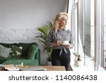 serious fifty year old female... | Shutterstock . vector #1140086438