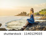 young woman tourist on the... | Shutterstock . vector #1140129035