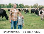 father and son smiling at... | Shutterstock . vector #1140147332