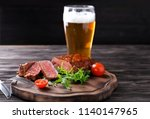 wooden board with tasty grilled ... | Shutterstock . vector #1140147965