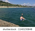 children jumping into the sea... | Shutterstock . vector #1140150848