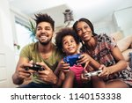 smiling family sitting on the... | Shutterstock . vector #1140153338
