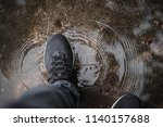 walking through a puddle   Shutterstock . vector #1140157688