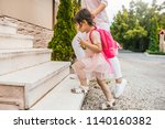 image of mother and pupil... | Shutterstock . vector #1140160382
