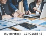 executive team discussing the... | Shutterstock . vector #1140168548
