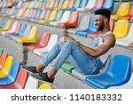 handsome african american man... | Shutterstock . vector #1140183332