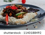 fried meat with rice in a plate | Shutterstock . vector #1140188492