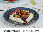 fried meat with rice in a plate | Shutterstock . vector #1140188495