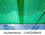 green shading net roof against... | Shutterstock . vector #1140208445