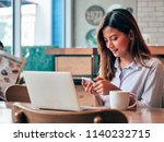asain woman working with laptop ... | Shutterstock . vector #1140232715
