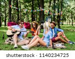 multicultural friends with... | Shutterstock . vector #1140234725
