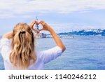 beautiful woman traveler makes... | Shutterstock . vector #1140246212