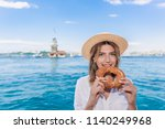 beautiful woman traveler eats...   Shutterstock . vector #1140249968