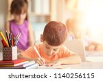 little boy doing homework at... | Shutterstock . vector #1140256115