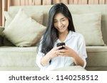 young asian woman serving... | Shutterstock . vector #1140258512