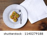 rolled baklava on a plate  fork ... | Shutterstock . vector #1140279188