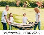 happy family with two kids... | Shutterstock . vector #1140279272