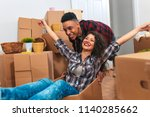 happy young couple moving into... | Shutterstock . vector #1140285662