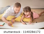 young father teaching daughter... | Shutterstock . vector #1140286172