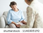 excited grandmother talking to...   Shutterstock . vector #1140305192