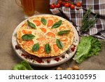 pizza thin with tomato  cheese  ... | Shutterstock . vector #1140310595