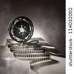 reel of film in retro style | Shutterstock . vector #114032002