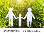 paper family on green grass | Shutterstock . vector #1140332312