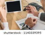 cropped shot of businessman and ... | Shutterstock . vector #1140339395