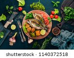 baked fish with spices and...   Shutterstock . vector #1140372518