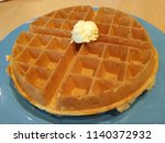 a big waffle with ice cream.   Shutterstock . vector #1140372932