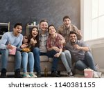 happy football fans watching... | Shutterstock . vector #1140381155